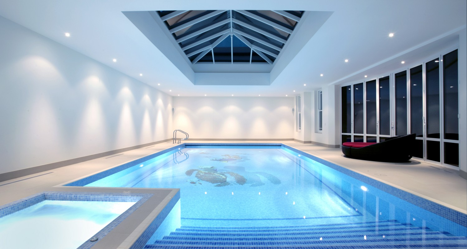 Indoor swimming pool design construction falcon for Construction pool house piscine