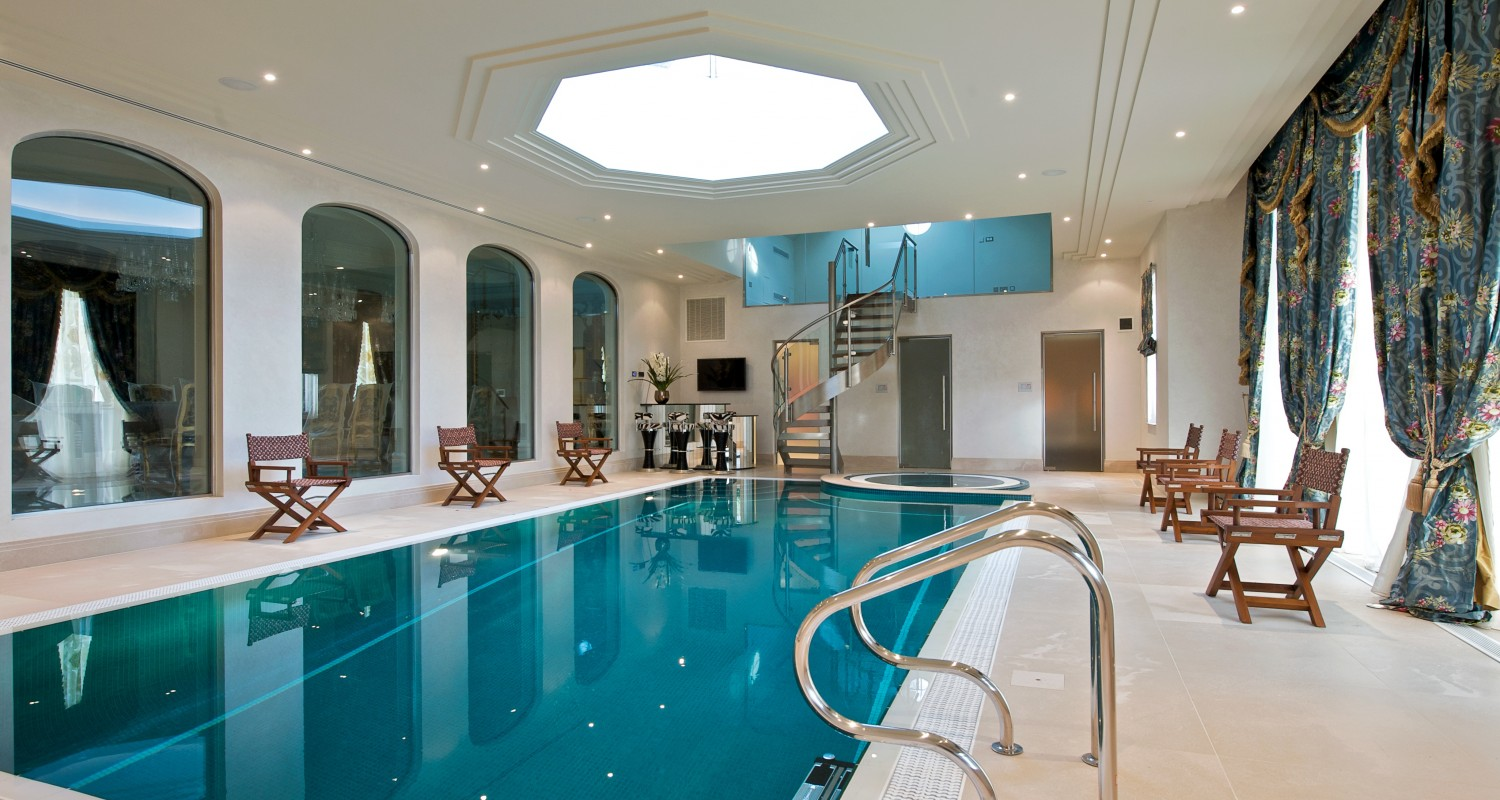 Indoor swimming pool design construction company for Indoor pool construction