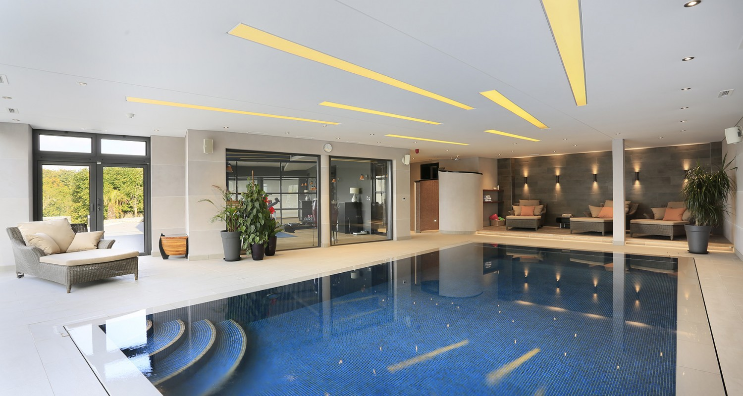 Indoor swimming pool design construction falcon pools for Pool house design uk