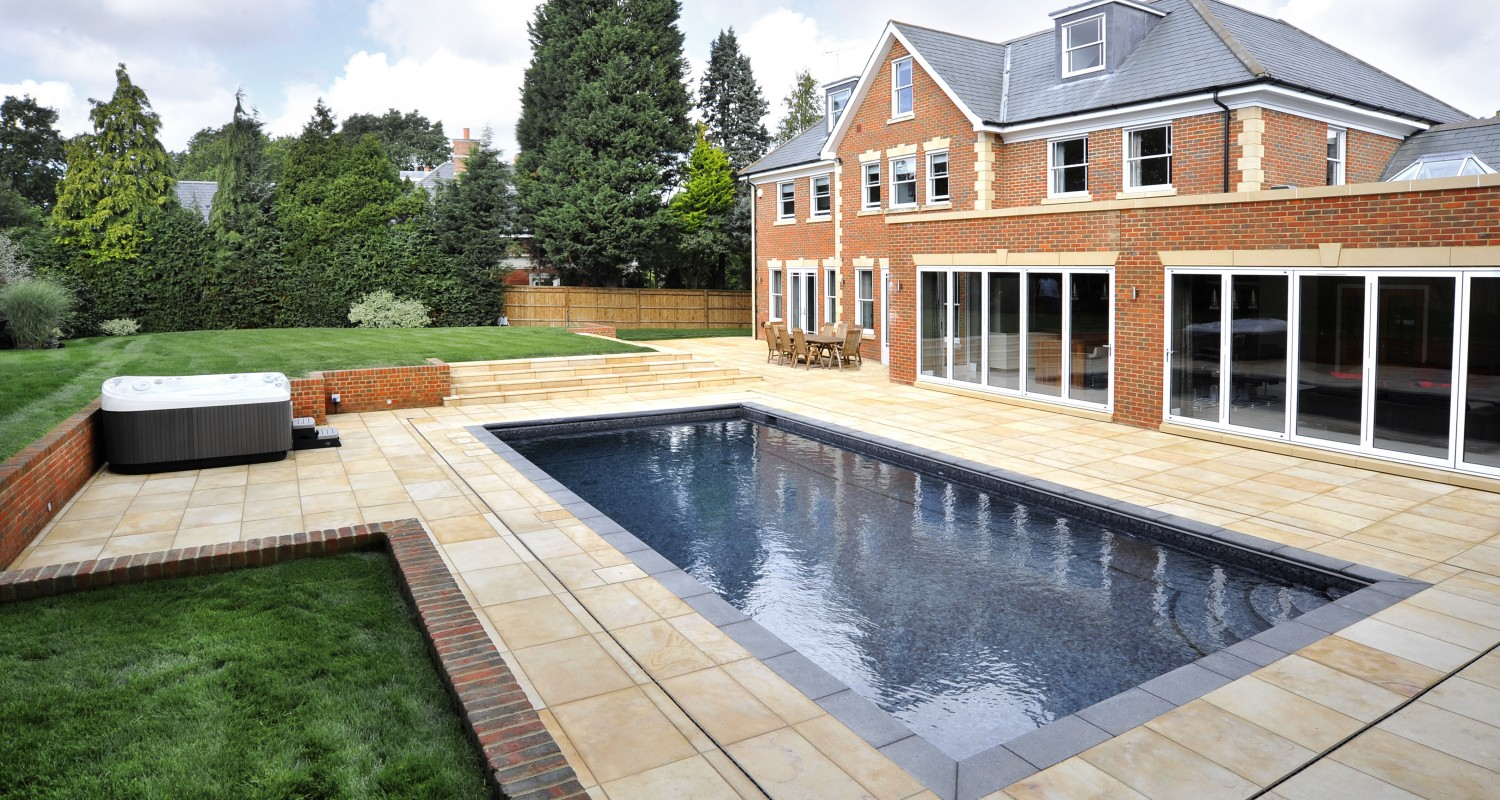 Outdoor swimming pool construction design falcon pools for Small garden swimming pools uk