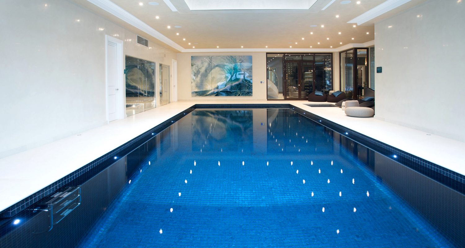 Indoor swimming pool design construction falcon for Home plans with pools