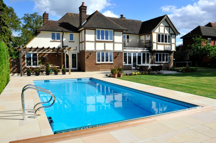 Outdoor pool with house