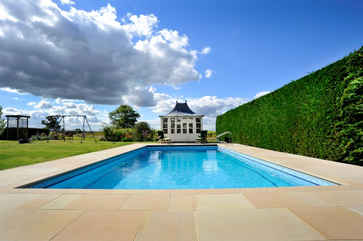 Outdoor pool with pool house