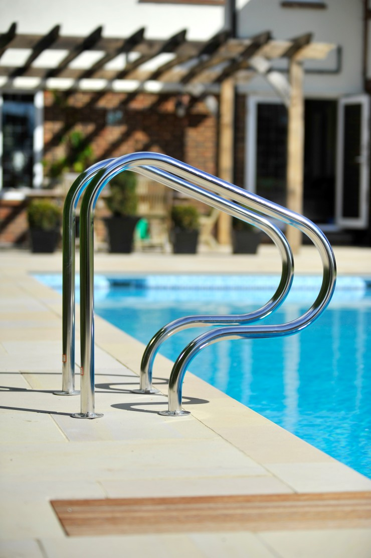 Swimming pool ladder handles