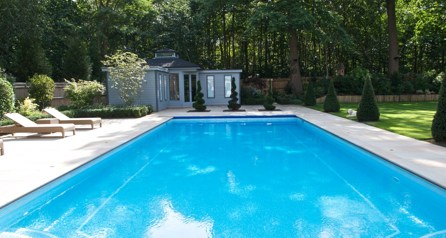 Outdoor swimming pool construction design falcon pools for Pool design by poolside
