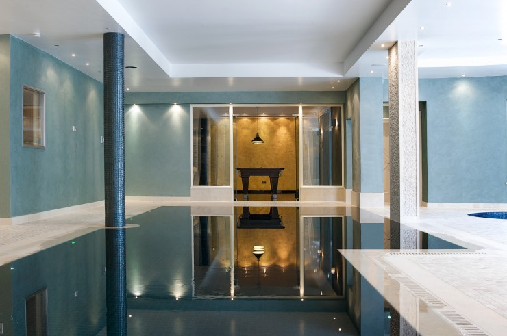 indoor pool with gold wall