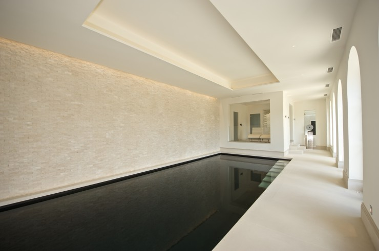 indoor pool with seating area