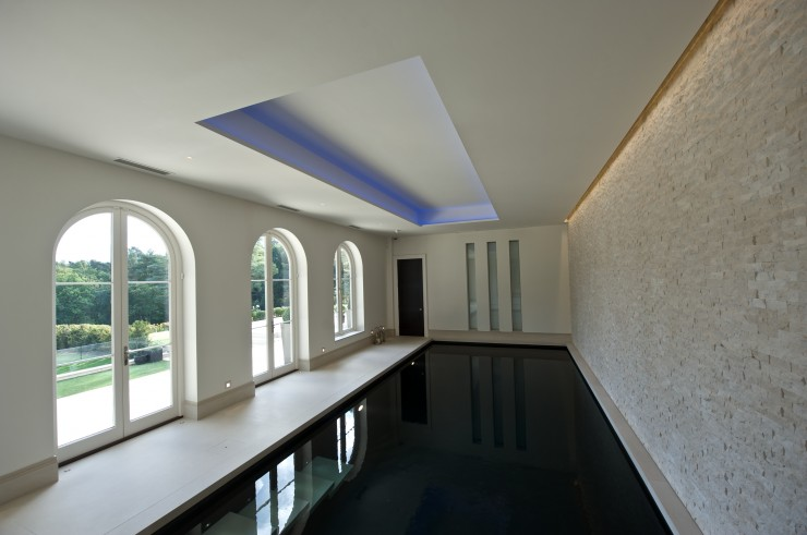 indoor pool with coloured lighting