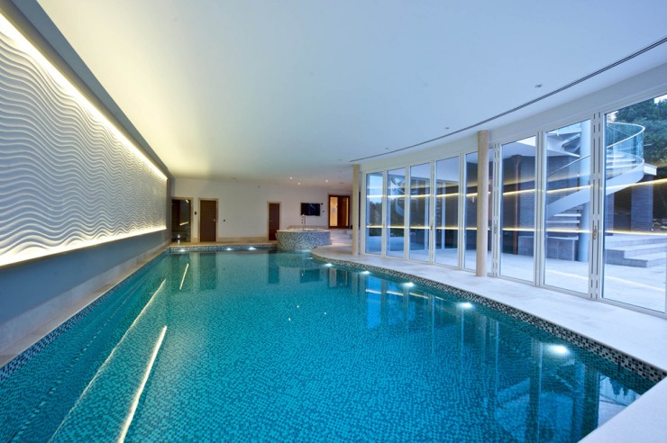 indoor pool with glass doors
