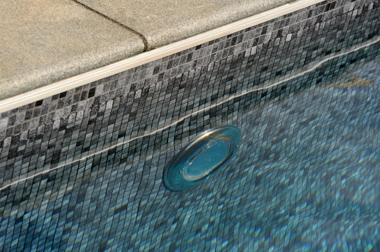 Outdoor pool lighting and tiles