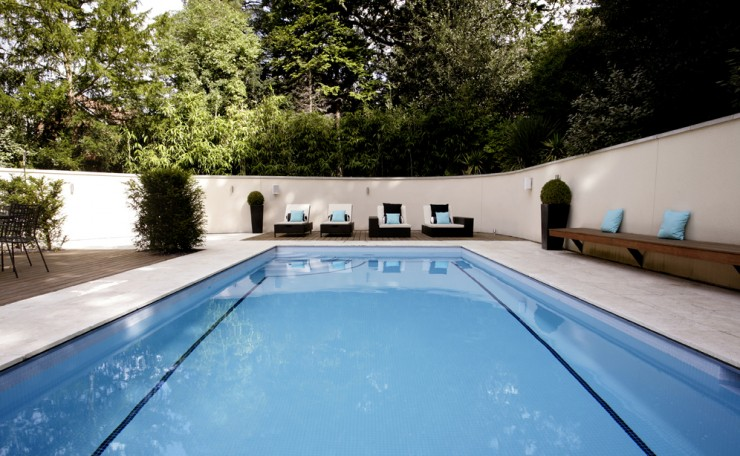 Outdoor pool with seating