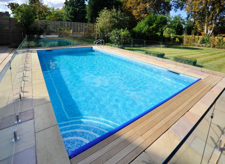 Outdoor pool with glass walls