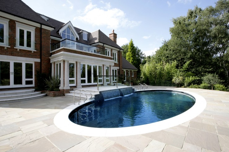 Outdoor pool with waterfall feature