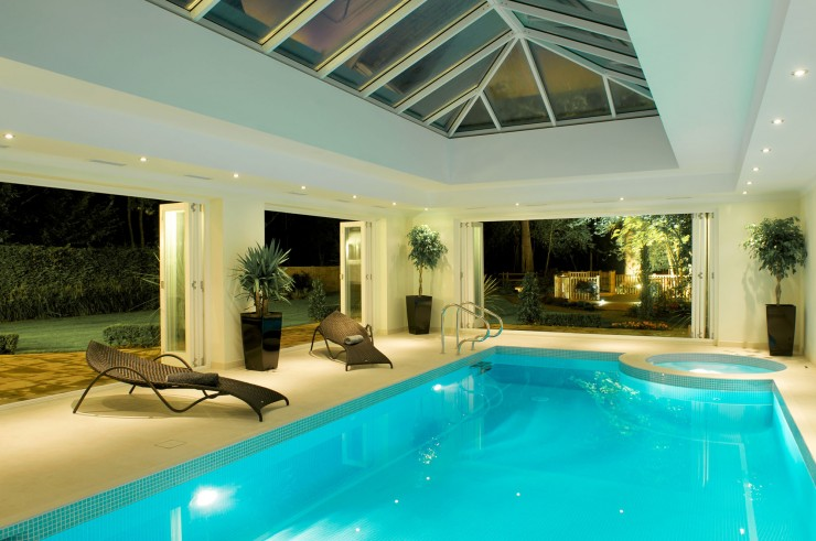 Indoor pool with spa and french doors