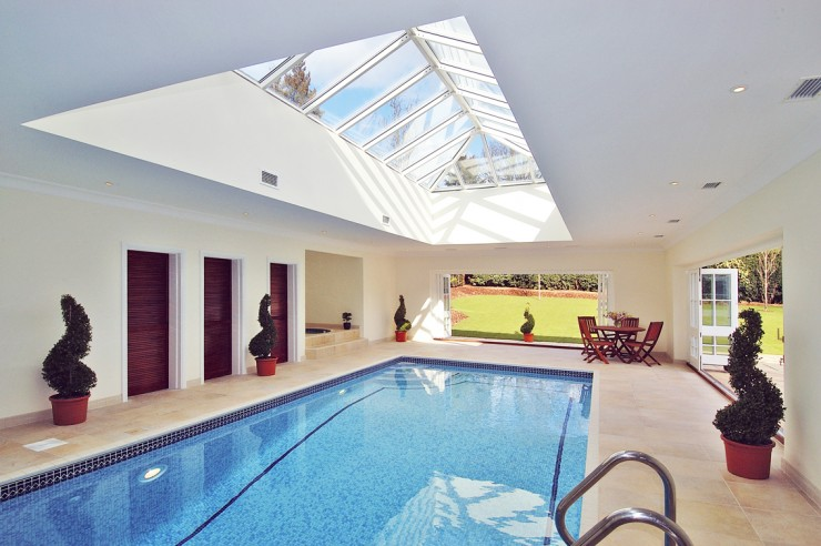 Indoor pool with detached spa