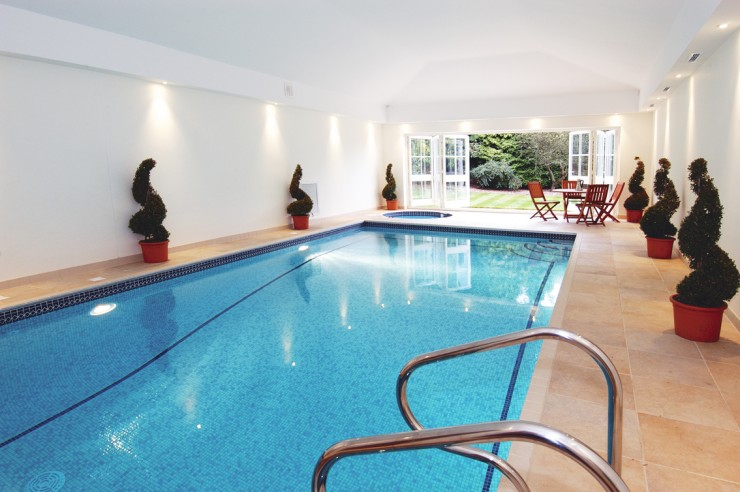 Indoor pool with french doors
