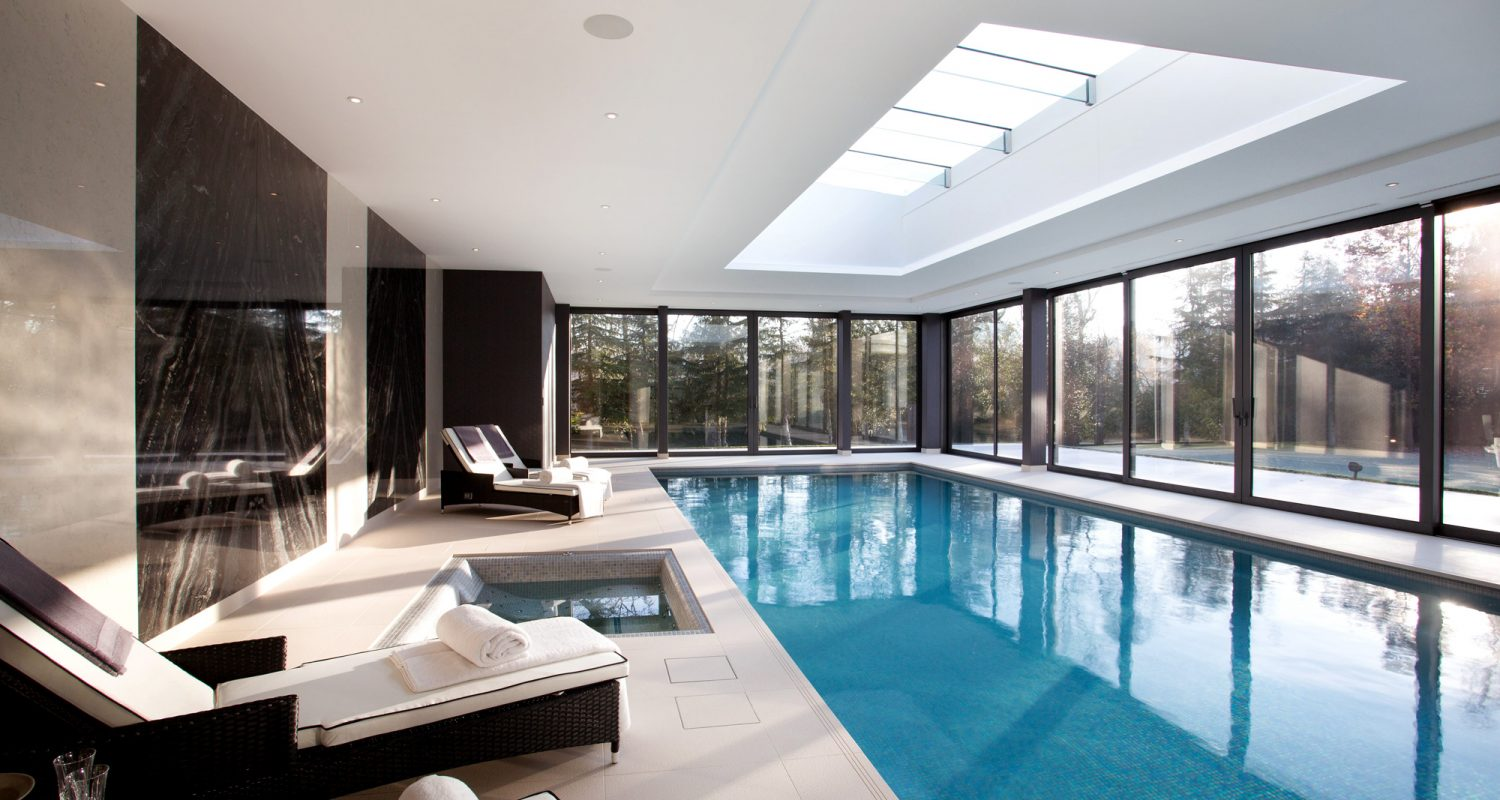 Indoor swimming pool design construction falcon pools for Mansion plans with indoor pool
